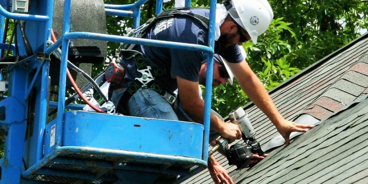 Roofers work on Ag Chiller Building