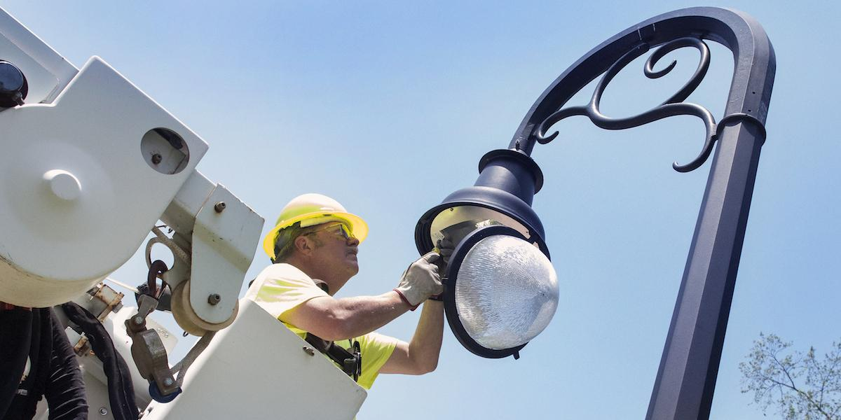 OPP worker changes a lightbulb