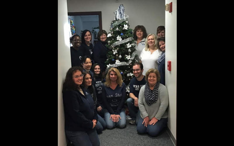 Photo of OPP employees with a Penn State holiday tree.