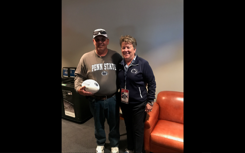 Photo of Greg Andrews receiving the game ball.