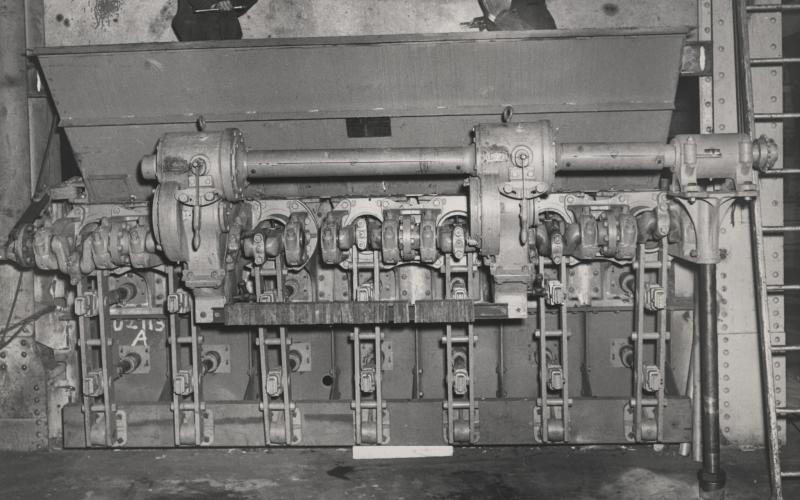 A photo of the boiler 5 multiple retort stoker and coal hopper during the 1940s-1970s