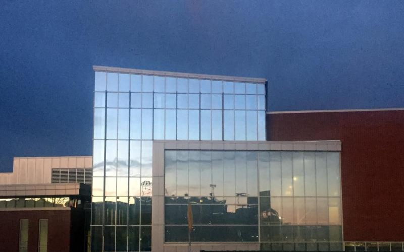 A photo of Beaver Stadium reflected on the IM Building