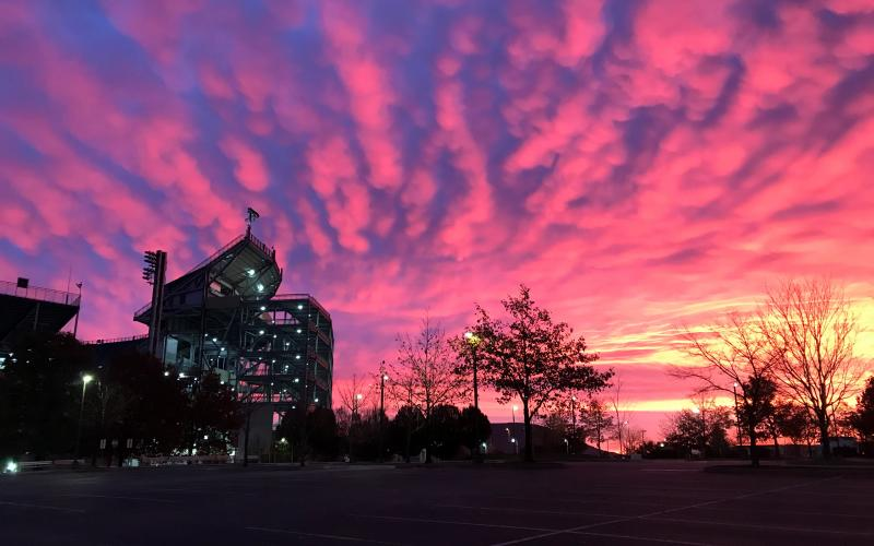 Photo of a sunrise next to Beaver Stadium.