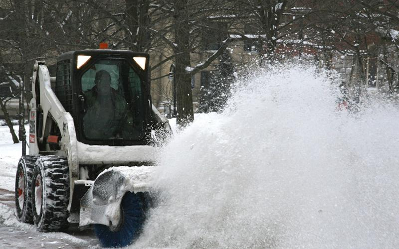 Snow brush cleans sidewalk along Pollock Rd.