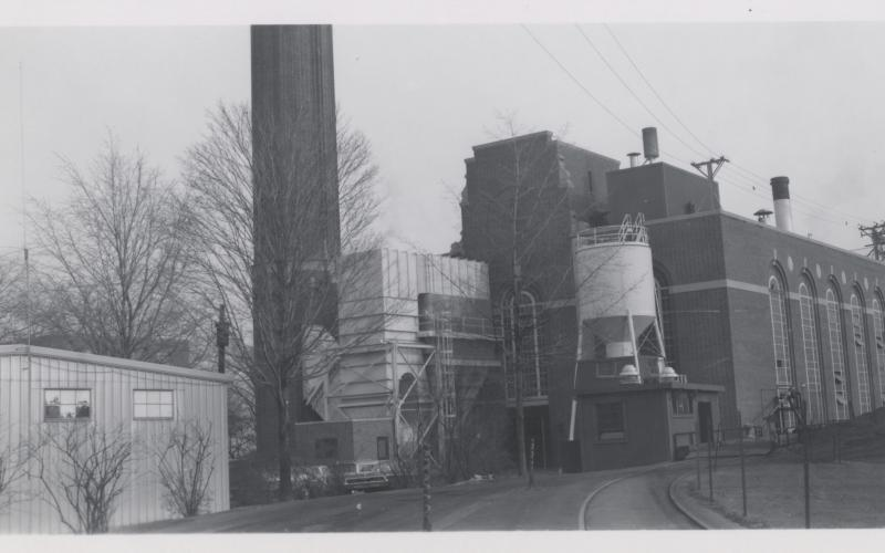 A photo of 1st Generation Pollution Control adjacent to chimney during the 1970s