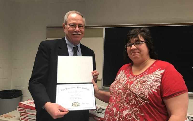 Susan Pilosky accepts 25 year award certificate from Ford Stryker