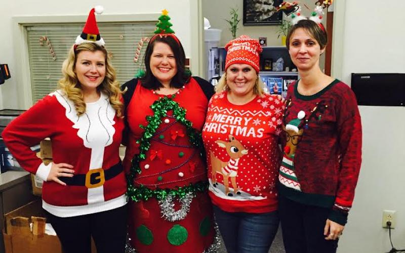 Photo of WRC employees in Christmas Sweaters