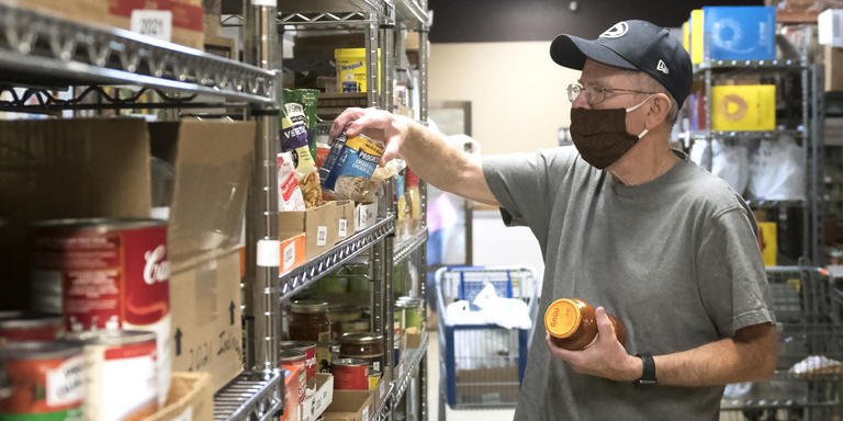 David Nelson stocks shelves with donated canned goods at the State College Food Bank on the morning of Nov. 30. Nelson, and his