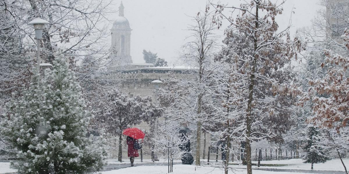 snow falls near old main