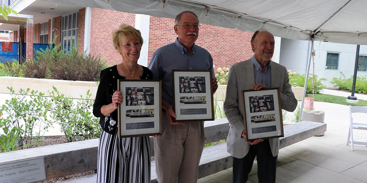 Three honored individuals pictured with plaques
