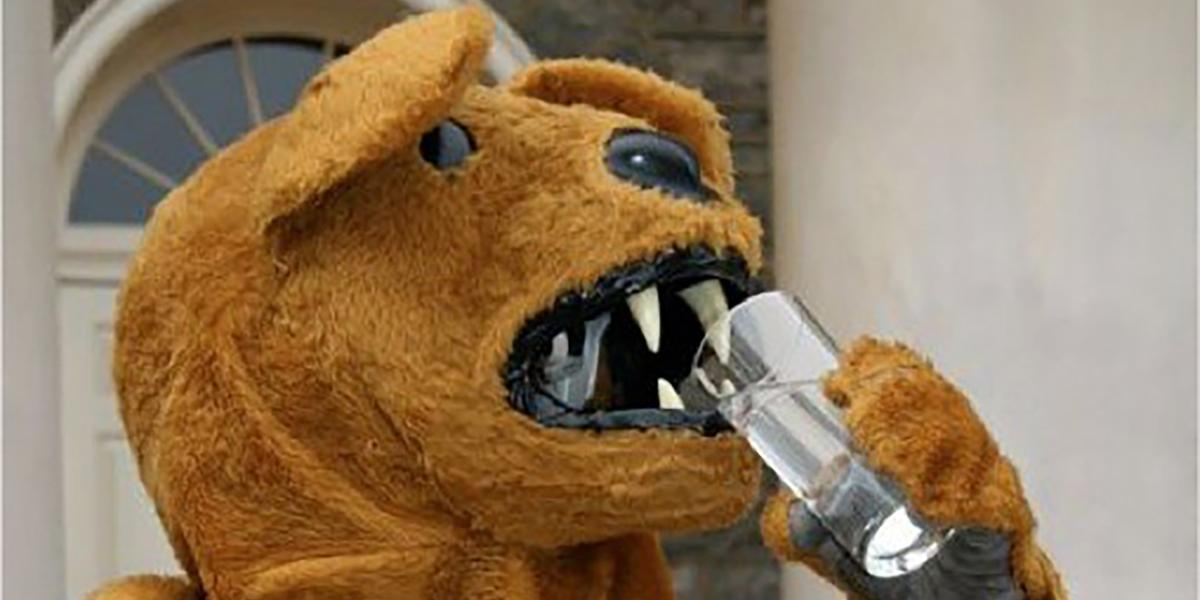 Nittany Lion drinks a glass of water